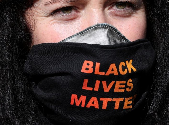 "A demonstrator wearing a ""Black Lives Matter"" face mask is pictured after police shut down a rally that was deemed unlawful, in Sydney, Australia, July 28, 2020. REUTERS/Loren Elliott"