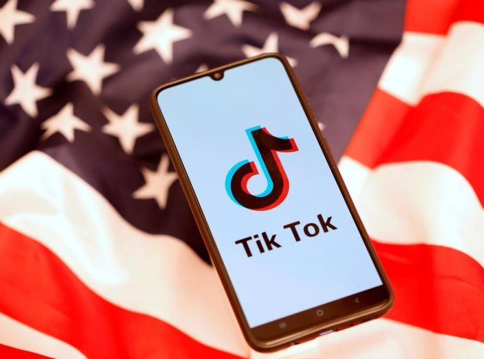 TikTok logo is displayed on the smartphone while standing on the U.S. flag in this illustration picture taken, November 8, 2019. REUTERS/Dado Ruvic