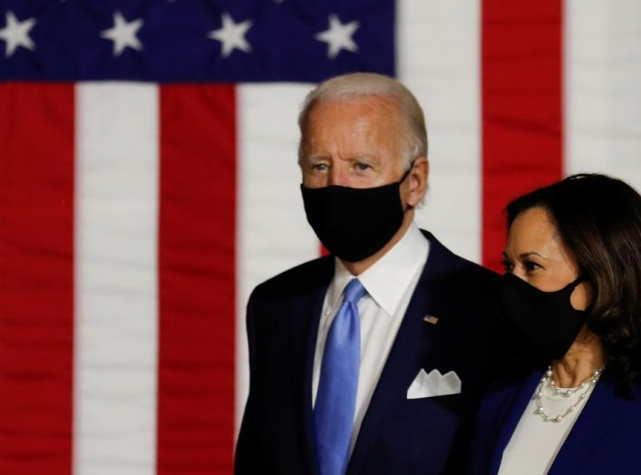 Democratic presidential candidate and former Vice President Joe Biden and vice presidential candidate Senator Kamala Harris take the stage at a campaign event, their first joint appearance since Biden named Harris as his running mate, at Alexis Dupont Hig