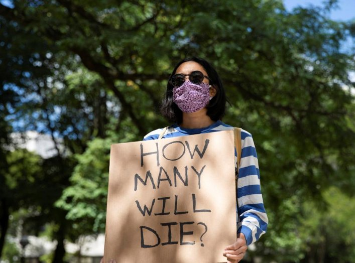Faculty member protests in-person classes for fall semester amid the coronavirus disease (COVID-19) pandemic, outside Fleming Administrative Building at the University of Michigan campus in Ann Arbor, Michigan, U.S., August 19, 2020. REUTERS/Emily Elconin