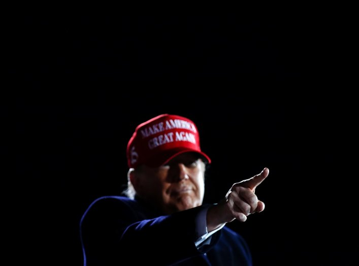 U.S. President Donald Trump points his finger during a campaign rally at Des Moines International Airport in Des Moines, Iowa, U.S., October 14, 2020. REUTERS/Carlos Barria