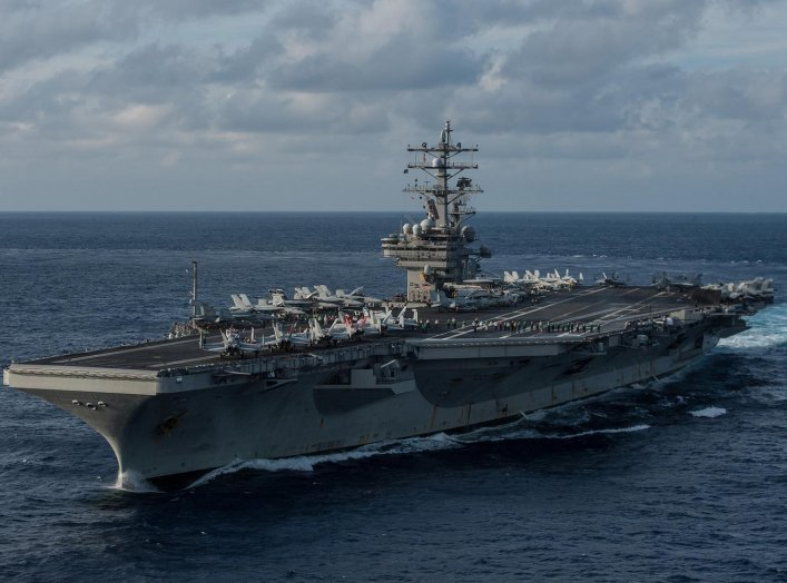 The U.S. Navy's forward-deployed aircraft carrier USS Ronald Reagan (CVN 76) transits the Philippine Sea ahead of Annual Exercise. 15 Nov. 2015. U.S. Navy/Mass Communication Specialist 3rd Class Nathan Burke.