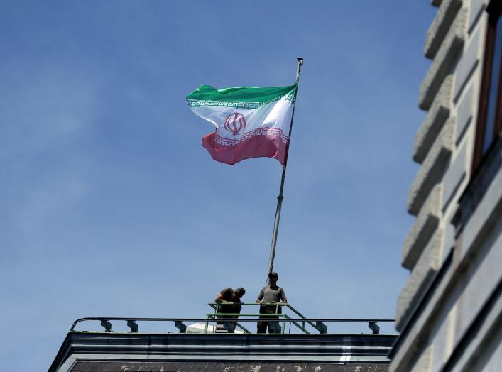 FILE PHOTO: The national flag of Iran is seen on top of the Austrian Chancellery during the visit of President Hassan Rouhani in Vienna, Austria July 4, 2018. REUTERS/Lisi Niesner/File Photo