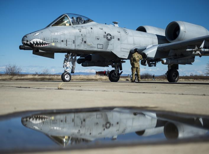 A member of the 100th Logistics Readiness Squadron refuels a 74th Expeditionary Fighter Squadron A-10C Thunderbolt II aircraft during forward area refueling point training at Plovdiv, Bulgaria, Feb. 11, 2016.