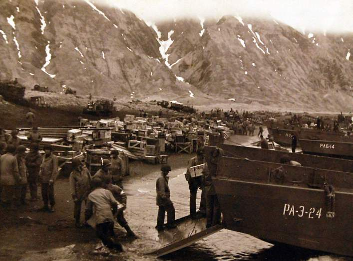 Aleutian Islands Campaign, June 1942 - August 1943. Unloading supplies on invasion beachhead, Attu, on the day of the attack, May 14, 1943. U.S. Navy
