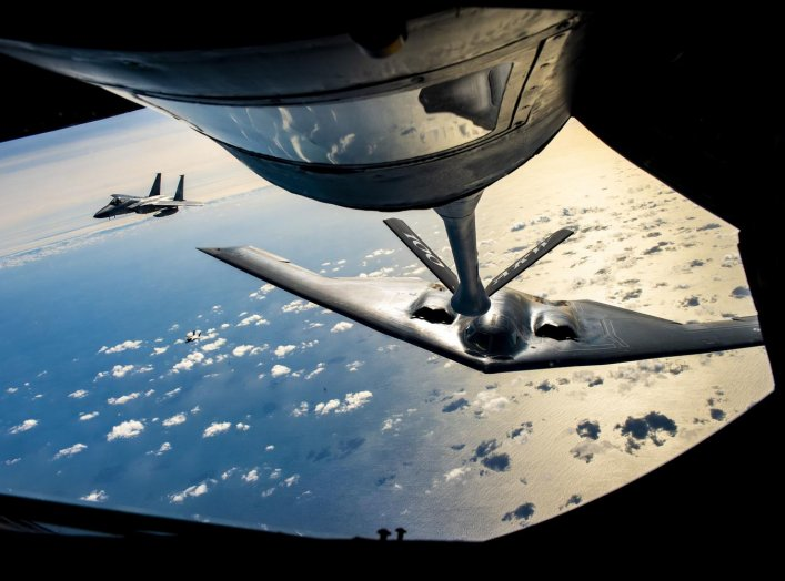 A B-2 Spirit Stealth Bomber from the 509th Bomb Wing, Whiteman Air Force Base, Missouri, flies behind a KC-135 Stratotanker from the 100th Air Refueling Wing, RAF Mildenhall, England, during a training mission for Bomber Task Force Europe over England on