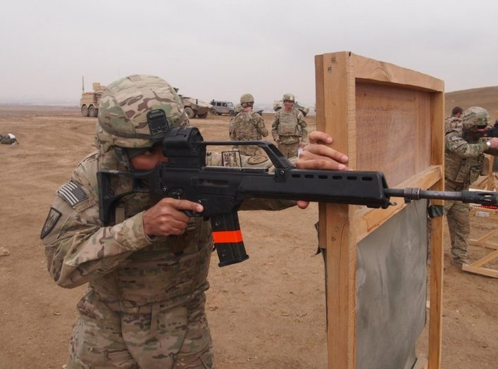 Pfc. Simeon Taylor, with Bravo Company, 427th Brigade Support Battalion, fires the German made Heckler & Koch G36 assault rifle during the qualification for the schützenschnur badge, at the German marksmanship range, on Nov. 17 in Mazare-e Sharif, Afghani