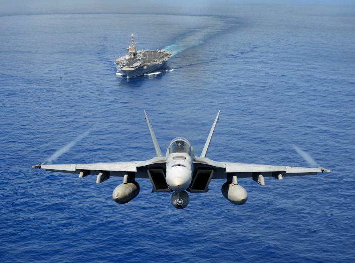 An F/A-18E Super Hornet participates in an air power demonstration near the aircraft carrier USS John C. Stennis (CVN 74) as the ship operates in the Pacific Ocean on April 24, 2013.
