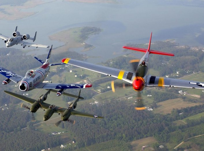 An A-10 Thunderbolt II, F-86 Sabre, P-38 Lightning and P-51 Mustang fly in a heritage flight formation during an air show at Langley Air Force Base, Va., on May 21. U.S. Air Force/Tech. Sgt. Ben Bloker.