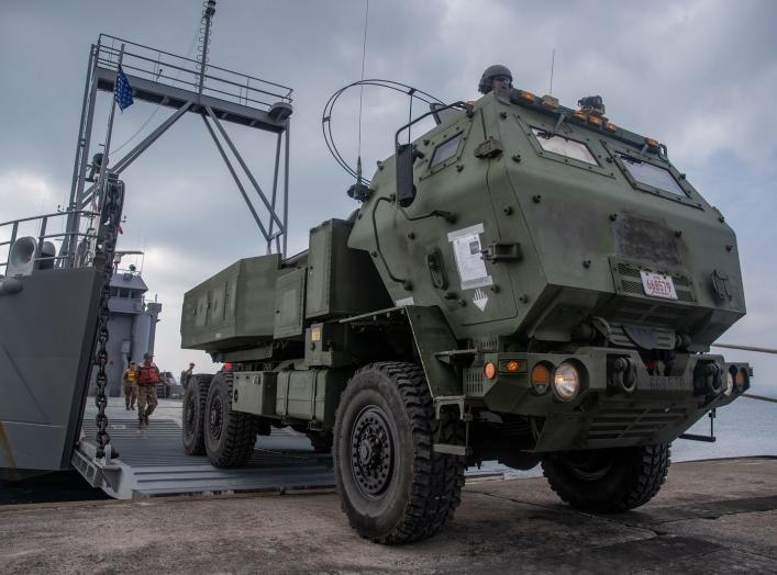 https://www.dvidshub.net/image/5874319/us-marine-high-mobility-artillery-rocket-system-embarks-army-landing-craft