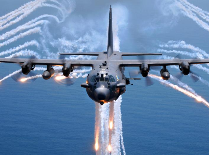 An AC-130H gunship from the 16th Special Operations Squadron, Hurlburt Field, Florida, jettisons flares as an infrared countermeasure during multi-gunship formation egress training on August 24, 2007.