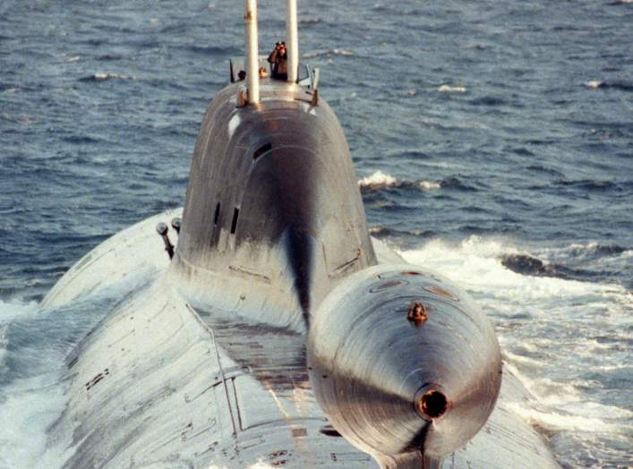 An aerial stern-on view of the Russian Northern Fleet AKULA class nuclear-powered attack submarine underway on the surface.