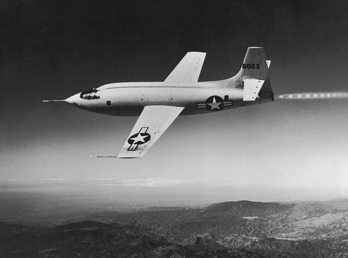 The #46-062 Bell X-1 rocket-powered experimental aircraft (known for becoming the first piloted aircraft to fly faster than Mach 1, or the speed of sound, on October 14, 1947) photographed during a test flight. NASA.