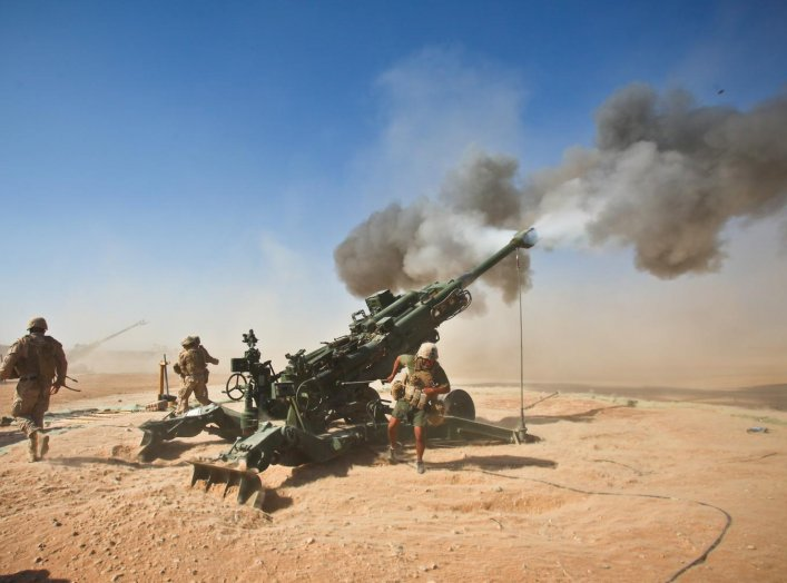 Marines with Charlie Battery, 1st Battalion, 12th Marine Regiment, fire an M982 Excalibur round from an M777 howitzer during a recent fire support mission. Afghanistan. 1 October 2011. U.S. Marine Corps.