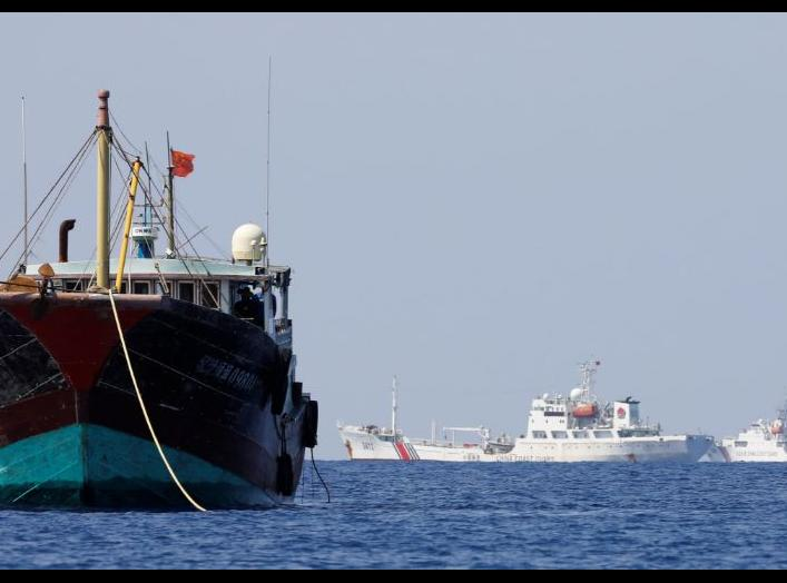 China Coast Guard vessels patrol past a Chinese fishing vessel at the disputed Scarborough Shoal, April 5, 2017. Picture taken April 5, 2017. REUTERS/Erik De Castro