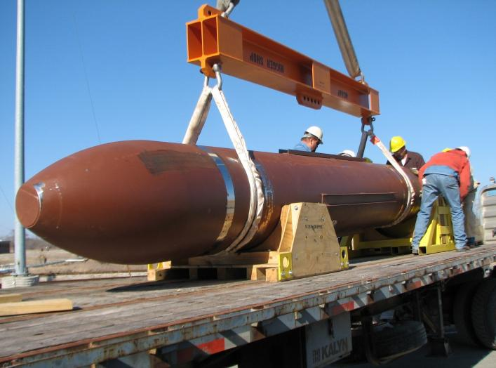 DTRA test personnel prepare to carefully off-load the 30,000 pound Massive Ordnance Penetrator (MOP) in preparation for a static test at White Sands Missile Range, N.M. (DTRA photo)