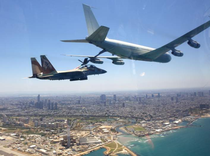 "A ""Re'em"" plane (Boeing 707) refueling a ""Ra'am"" plane (F-15I) above the beaches of Tel-Aviv. May 10, 2011."