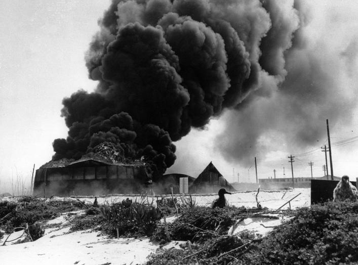 Battle of Midway, June 1942. Burning oil tanks on Sand Island, Midway, following the Japanese air attack delivered on the morning of 4 June 1942.