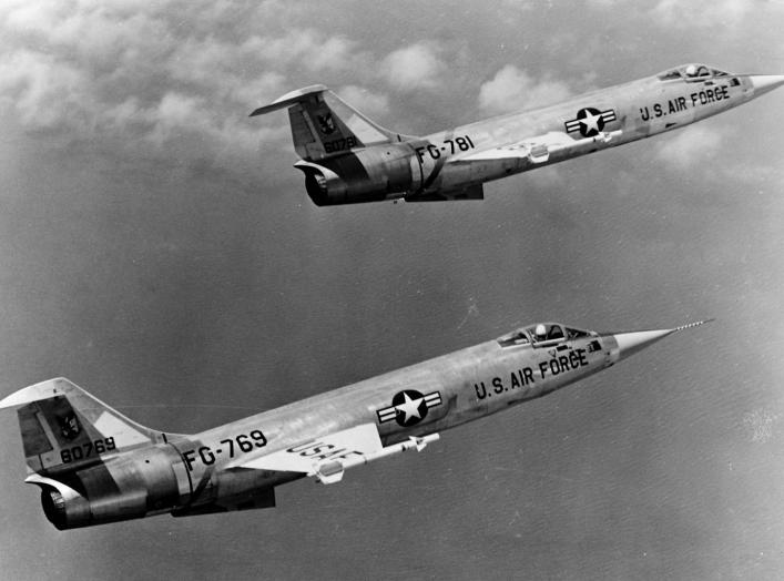 A formation of two U.S. Air Force Lockheed F-104A-15-LO Starfighters (s/n 56-0769 and 56-0781) in flight. Circa 1960. National Museum of the US Air Force.