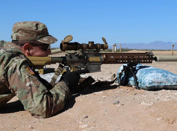 An Infantry Soldier along with 15 additional Soldiers assigned to Alpha Company, 4-17 Infantry Battalion, 1st Stryker Brigade Combat Team, 1st Armored Division, fires rounds down range with the newly developed Squad Designated Marksman Rifle (SDM-R), Jan.