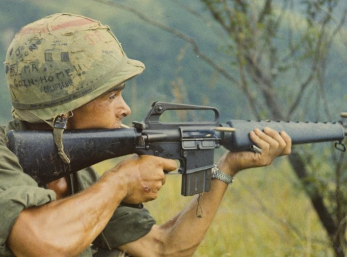 PFC Michael J. Mendoza (Piedmont, CA.) fires is M-16 rifle into a suspected Viet Cong occupied area. 8 September 1967, Quang Ngai Province, Republic of Vietnam. U.S. Army/Sp5 Robert C. Lafoon.