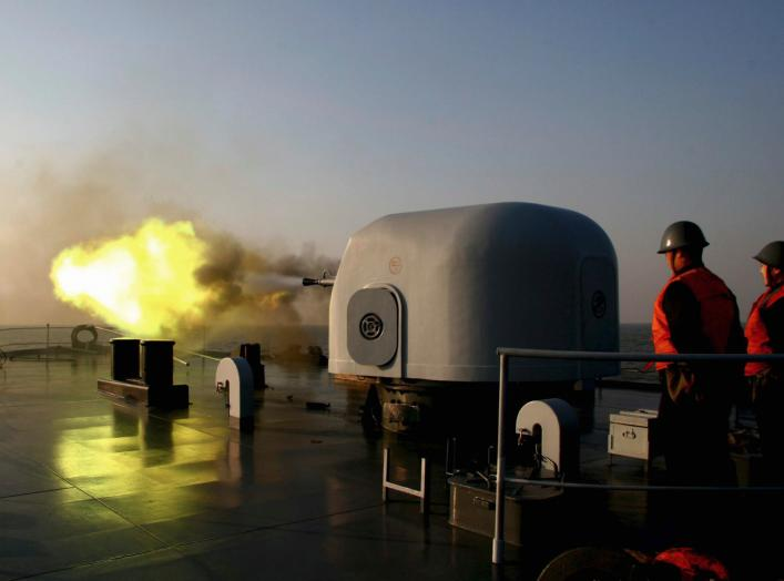 A battleship fires during an exercise on the East China Sea February 2, 2007. Picture taken February 2, 2007. CHINA OUT REUTERS/China Daily