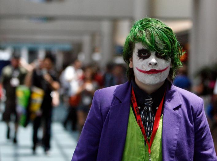 "A visitor dressed like the Joker character from the movie ""The Dark Knight"" walks during the 40th annual Comic Con Convention in San Diego July 23, 2009. The convention runs July 23-26. REUTERS/Mario Anzuoni"