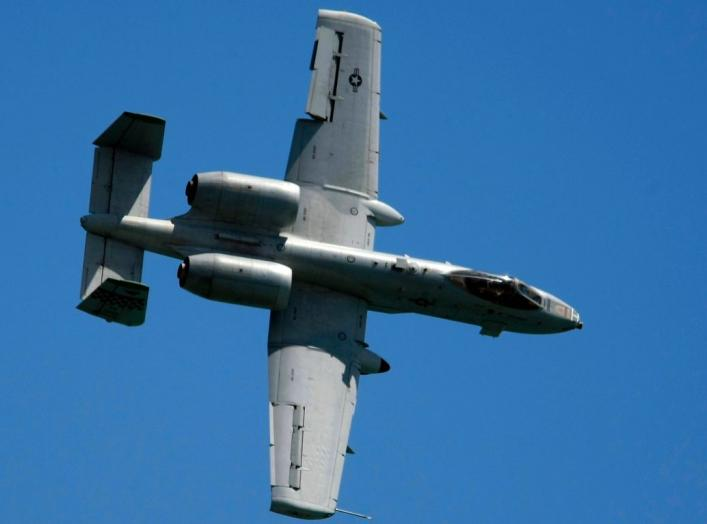 A U.S. Air Force (USAF) A-10 Thunderbolt II ground-attack aircraft performs a manoeuvre during the Singapore Airshow February 2, 2010. REUTERS/Tim Chong (SINGAPORE - Tags: BUSINESS TRANSPORT MILITARY)