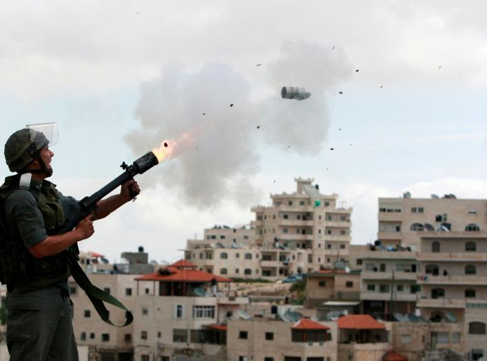 "An Israeli border police officer fires tear gas towards Palestinian stone-throwers in East Jerusalem neighbourhood of Issawiya March 16, 2010. Dozens of Palestinian stone-throwers clashed with Israeli police in East Jerusalem on Tuesday on a ""day of rage"""