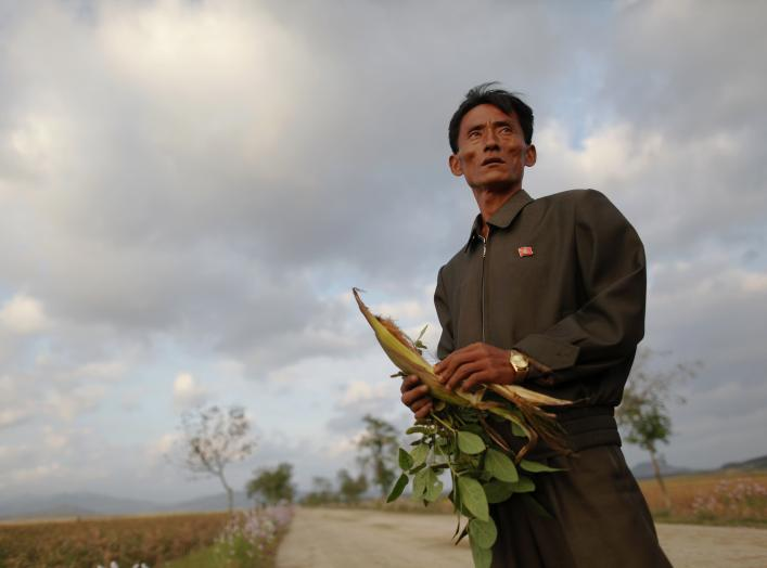 Pak Su Dong, manager of the Soksa-Ri cooperative farm in the area hit by recent floods and typhoons shows damage to agricultural products in the South Hwanghae province September 29, 2011. In March, the World Food Programme (WFP) estimated that 6 million