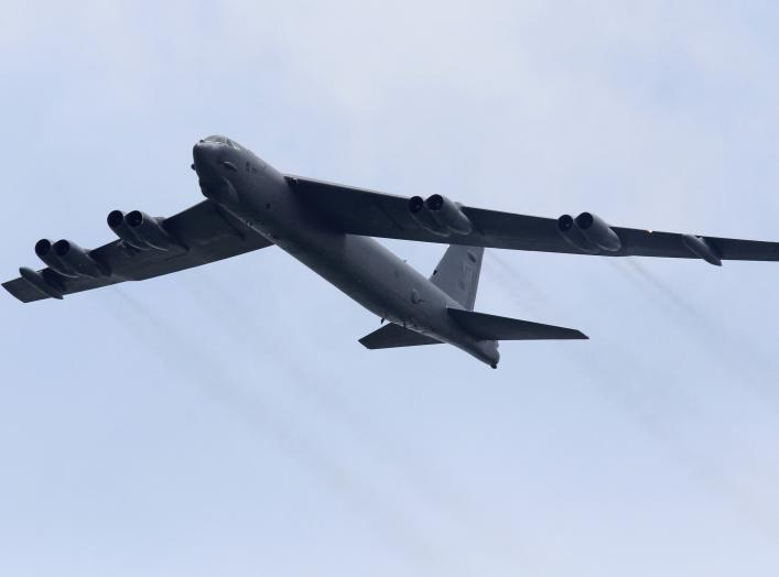 A Boeing B-52 Stratofortress strategic bomber from the United States Air Force (USAF) Andersen Air Force Base in Guam performs a fly-past during an aerial display at the Singapore Airshow in Singapore February 14, 2012.