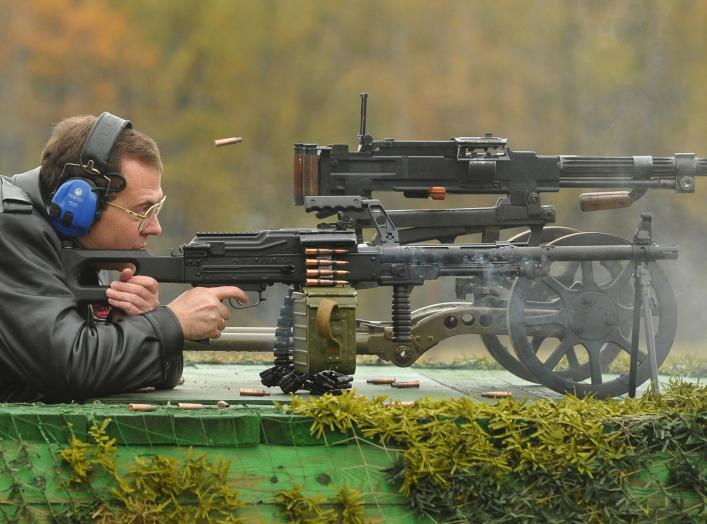 Russia's Prime Minister Dmitry Medvedev takes part in testing small arms at the training ground of the Central Research Institute for Precision Machine Building in Klimovsk, Moscow Region October 3, 2012. REUTERS/Alexander Astafyev/RIA Novosti/Pool (RUSSI
