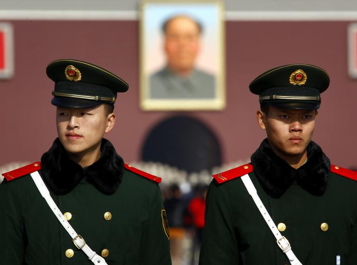 Paramilitary policemen stand guard on Beijing's Tiananmen Square November 6, 2012 as security is tightened around the square and the adjoining Great Hall of the People. Just days before the party's all-important congress opens, China's stability-obsessed