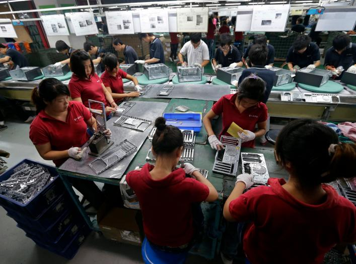 Employees work at a Foxconn factory in Wuhan, Hubei province, in this August 31, 2012 picture. REUTERS/Stringer (CHINA)