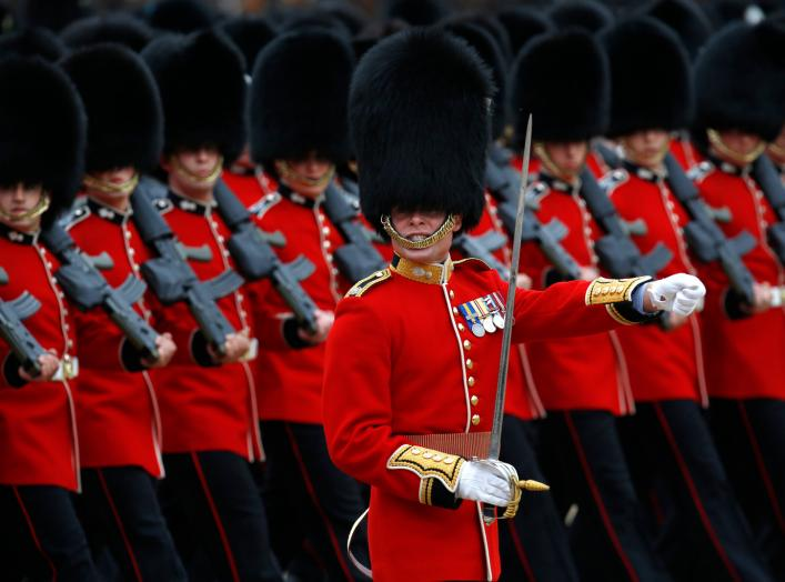 Guardsmen of the Grenadier Guards parade during the Trooping the Colour ceremony at Horse Guards Parade in London June 14, 2014. Trooping the Colour is a ceremony to honour the Queen's official birthday. REUTERS/Luke MacGregor