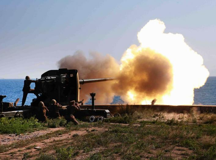 Soldiers fire an artillery piece during a visit by North Korean leader Kim Jong Un to inspect the defence detachment on Ung Islet, which is defending an outpost in the East Sea of Korea, in this undated photo released by North Korea's Korean Central News