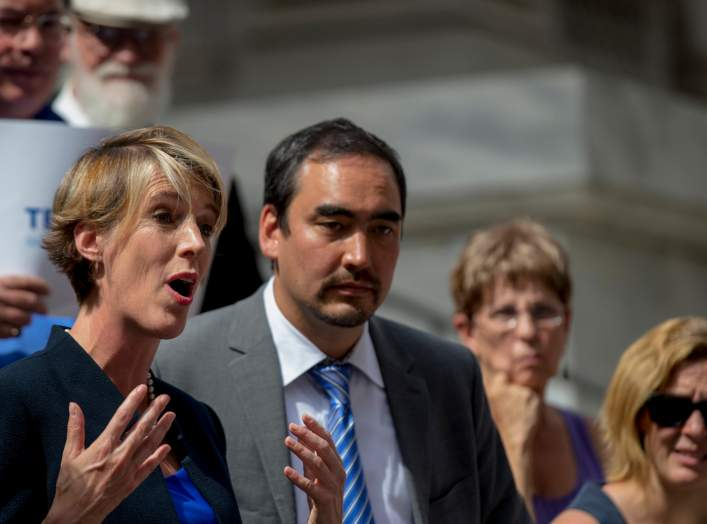 New York State democratic governor candidate Zephyr Teachout (L) speaks next to lieutenant governor candidate running mate Tim Wu (2nd L) during a campaign event in New York September 3, 2014.