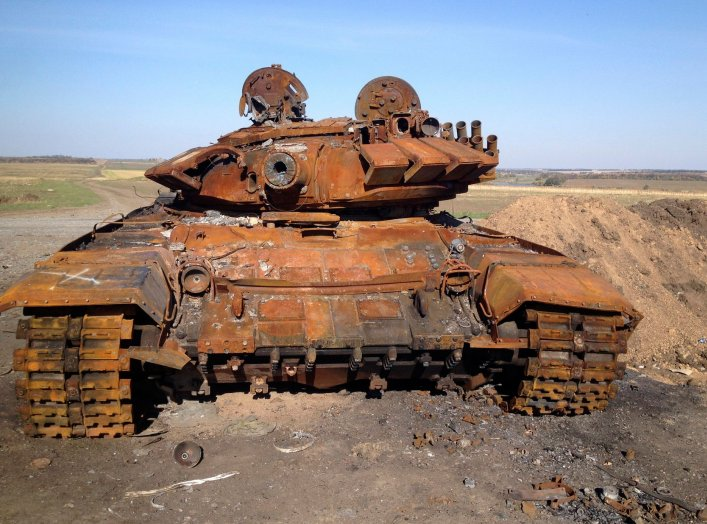 A destroyed T-72 tank, which presumably came from Russia, is seen on a battlefield near separatist-controlled Starobesheve, eastern Ukraine, October 2, 2014. The burnt-out remains of dozens of tanks and armoured vehicles in fields near the small village o