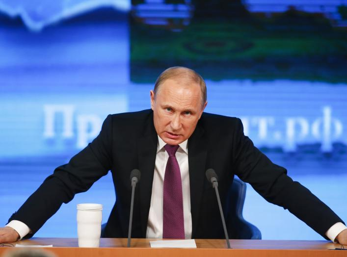 Russian President Vladimir Putin speaks during his annual end-of-year news conference in Moscow, December 18, 2014. The rouble edged lower against the dollar on Thursday, with traders saying President Vladimir Putin had offered few concrete measures at hi