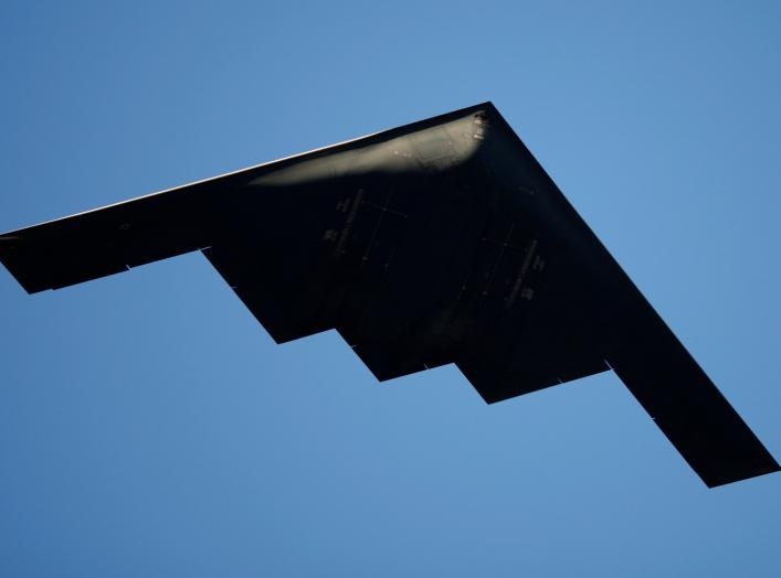 A B-2 Stealth Bomber performs a flyover at the 126th Rose Parade in Pasadena, California January 1, 2015. REUTERS/David McNew (UNITED STATES - Tags: TRANSPORT MILITARY ANNIVERSARY)