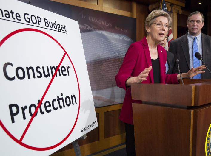 Senators Elizabeth Warren (D-MA), Al Franken (hidden)(D-MN) and Jeff Merkley (D-OR) hold a news conference to warn about the abolishment of Consumer Financial Protection Bureau in the proposed budget put forward by Senate Republicans on Capitol Hill