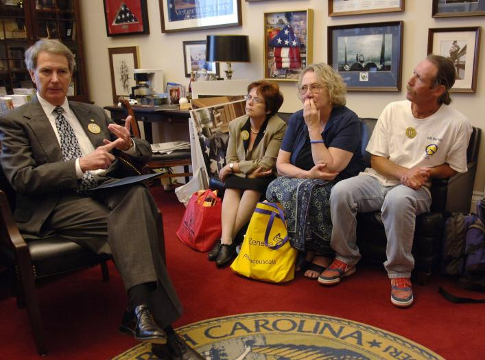 U.S. Representative Walter Jones (L) (R-NC), meets with Gold Star and Military Families in his Capitol Hill office in Washington, D.C., June 15, 2005. Seated are (L-R) Dianne Davis Santorello, mother of Lt. Neil Santorello; Celeste Zappala, mother of Sgt.