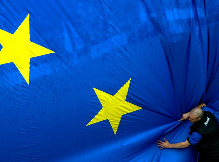 A worker adjusts a 150 metre-square European flag during a celebration in Brussels' Jubilee Park to mark the expansion of the European Union to 25 from 15 states on April 30, 2004. Cyprus, the Czech Republic, Estonia, Hungary, Latvia, Lithuania, Malta, Po