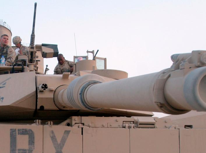 U.S. troops sit on an Abrams M1 tank as they prepare to join a military offensive in the northern Iraq city of Tal Afar September 10, 2005.