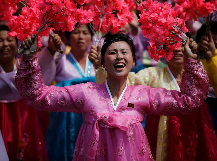 Women wearing traditional clothes react as they march past the stand with North Korean leader Kim Jong Un during a military parade marking the 105th birth anniversary of the country's founding father Kim Il Sung, in Pyongyang April 15, 2017. REUTERS/Damir