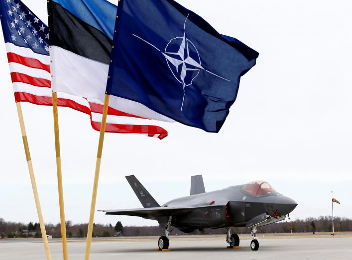 U.S., Estonia's and NATO flags flutter next to the U.S. Air Force F-35A Lightning II fighter in Amari air base, Estonia, April 25, 2017. REUTERS/Ints Kalnins