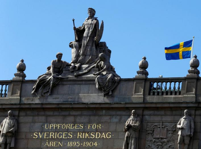 The Swedish flag flutters next to the Riksdag, the Swedish Parliament, in Stockholm, Sweden, May 7, 2017. REUTERS/Ints Kalnins