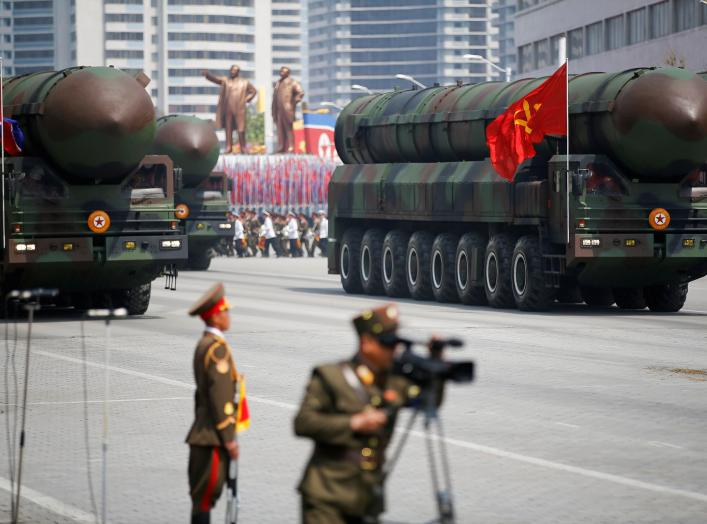 Intercontinental ballistic missiles (ICBM) are driven past the stand with North Korean leader Kim Jong Un and other high ranking officials during a military parade marking the 105th birth anniversary of country's founding father Kim Il Sung, in Pyongyang