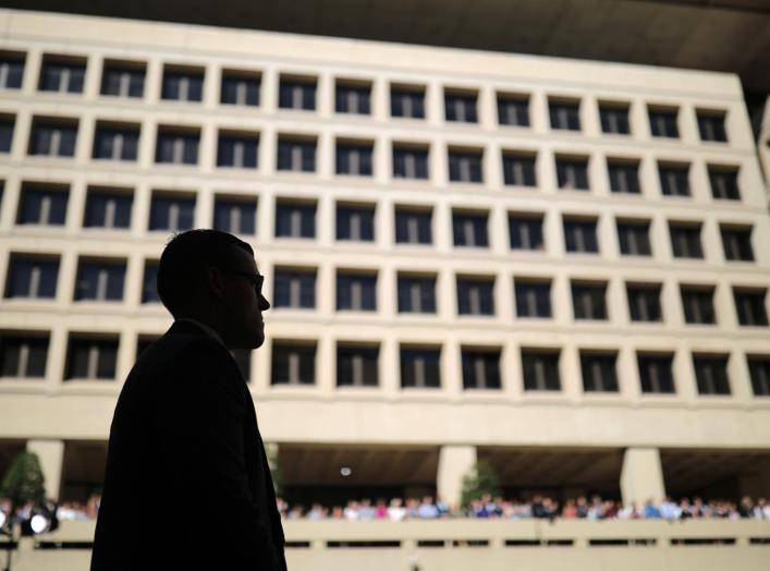Federal Bureau of Investigation agents and employees listen to incoming FBI Director Christopher Wray speak after taking the oath of office at FBI headquarters in Washington, U.S., September 28, 2017. REUTERS/Carlos Barria