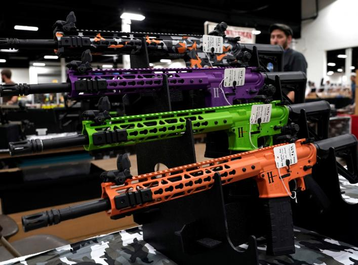 AR-15 rifles with colored hand guards are displayed for sale at the Guntoberfest gun show in Oaks, Pennsylvania, U.S., October 6, 2017. REUTERS/Joshua Roberts